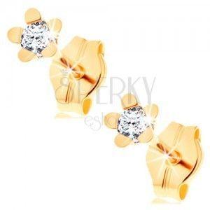 Kolczyki z żółtego 14K złota - lśniący kwiat o pięciu płatkach, okrągła przezroczysta cyrkonia obraz