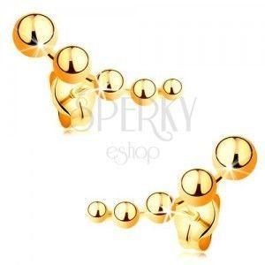 Kolczyki wkręty z żółtego złota 585 - zmniejszające się kuleczki obraz