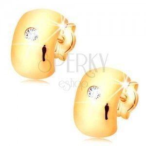 Kolczyki z żółtego 14K złota - świecący, bezbarwny diament na szerokim łuku obraz
