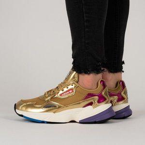 Złote sneakersy damskie obraz