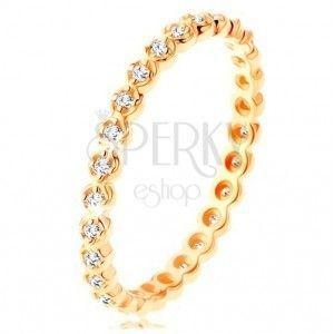 Złoty pierścionek 375 - okrągłe przezroczyste cyrkonie dookoła, faliste krawędzie obraz