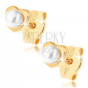 Kolczyki z żółtego złota 9K - małe lśniące serduszko, okrągła perełka obraz