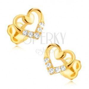 Złote kolczyki 585 - symetryczny zarys serca z mniejszym pełnym serduszkiem, cyrkonie obraz