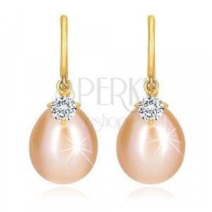 Diamentowe kolczyki z 14K złota - lśniący łuk, owalna perła i brylant. obraz