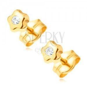 Złote kolczyki 585 - drobny kwiatek z bezbarwnym błyszczącym diamentem obraz