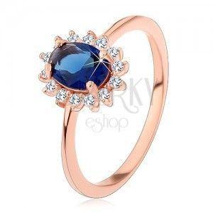 Srebrny pierścionek miedzianego koloru, ciemnoniebieska owalna cyrkonia w przezroczystej oprawie obraz