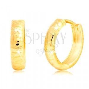 Złote kolczyki 585 - okrągłe, z płytkimi nieregularnymi wycięciami obraz