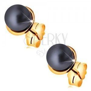 Złote kolczyki 585 - małe lśniące kółko z czarną okrągłą perłą, wkręty obraz