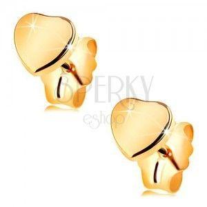 Złote kolczyki 585 - lśniące symetryczne serduszko, gładka powierzchnia obraz