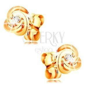Diamentowe kolczyki z żółtego złota 585 - węzeł z trzech pierścieni, przezroczysty diament obraz