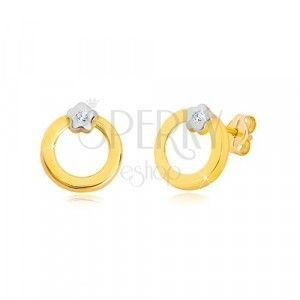 Brylantowe kolczyki z 14-karatowego złota - krążek z diamentem w kwiatku z białego złota obraz