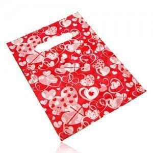 Igielitowy woreczek prezentowy, serduszkowy nadruk na czerwonym tle obraz