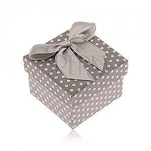 Szaro-białe kropkowane pudełko na pierścionek, lśniąca kokardka obraz
