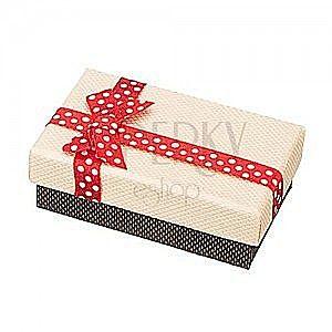 Pudełko ze wstążką w kropki na komplet biżuterii obraz