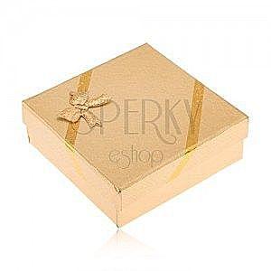 Pudełeczko prezentowe w złotym kolorze na biżuterię, wygląd tkaniny, kokardka obraz