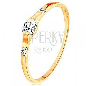 Złoty pierścionek 375 - trzy przezroczyste cyrkoniowe kwadraciki, lśniące i gładkie ramiona obraz