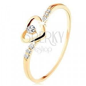 Złoty pierścionek 375, kontur serca z przezroczystą cyrkonią, ozdobione ramiona obraz