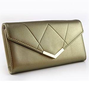 Złoty portfel damski obraz